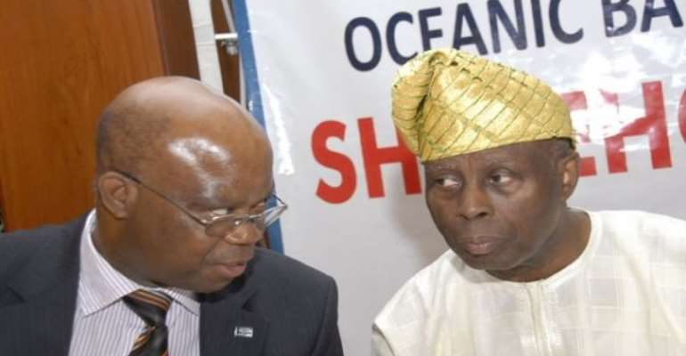 PHOTO: L-R: OCEANIC BANK GMD, MR JOHN ABOH WITH BANK CHAIRMAN, APOSTLE HAYFORD ALILE AT OCEANIC'S INTERACTIVE SESSION WITH SHAREHOLDERS.