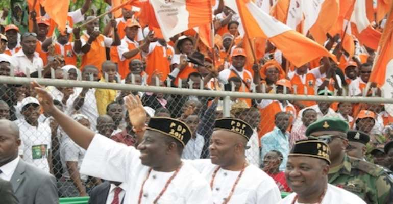 L-R: PRESIDENT GOODLUCK JONATHAN, AKWA IBOM STATE GOVERNOR GODSWILL AKPABIO AND VICE PRESIDENT NAMADI SAMBO AT THE PRESIDENTIAL RALLY OF THE PEOPLES DEMOCRATIC PARTY (PDP) IN UYO TODAY, MARCH 07, 2011.