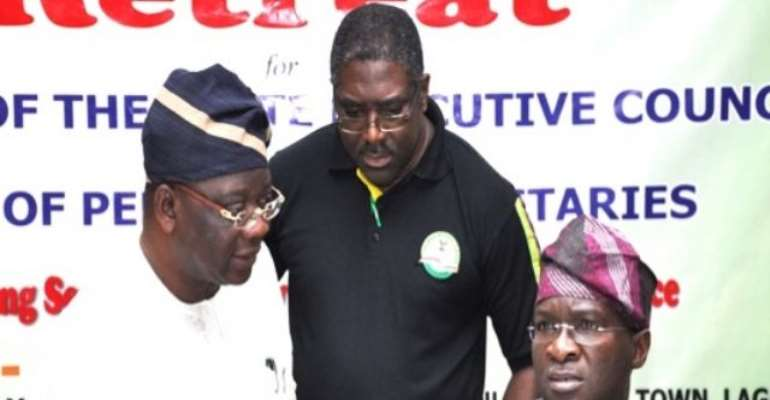 PHOTO: LAGOS STATE GOVERNOR BABATUNDE FASHOLA (R) DISCUSSING WITH SPECIAL ADVISER, WORKS AND INFRASTRUCTURE, ENGR. GANIYU JOHNSON (L) AND EXECUTIVE CHAIRMAN, LAGOS INLAND REVENUE SERVICES (LIRS), MR RUNDE FOWLER, DURING THE RETREAT.