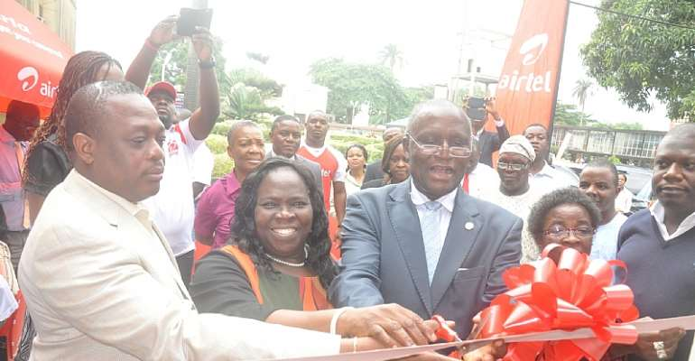 Deputy Vice Chancellor, Management, Unilag, Prof. Duro Oni cutting the tape to open the new Airtel's Service Point at the University of Lagos