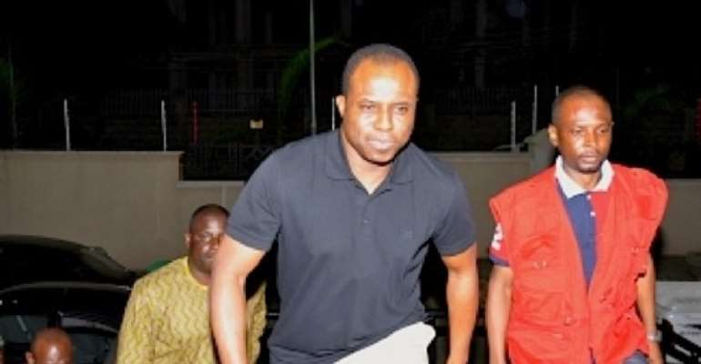 FORMER HOUSE SPEAKER DIMEJI BANKOLE WITH EFCC OPERATIVES ON THE NIGHT OF HIS ARREST IN ABUJA.