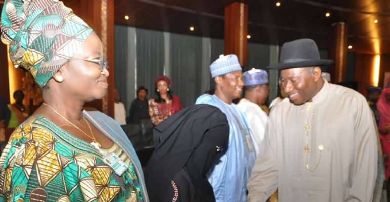 PRESIDENT JONATHAN SHAKING HANDS WITH A MEMBER OF THE COMMITTEE ON DIALOGUE & PEACEFUL RESOLUTION OF SECURITY CHALLENGES IN THE NORTH, BARR AISHA WAKILI DURING THEIR INAUGURATION IN ABUJA. APRIL 24, 2013