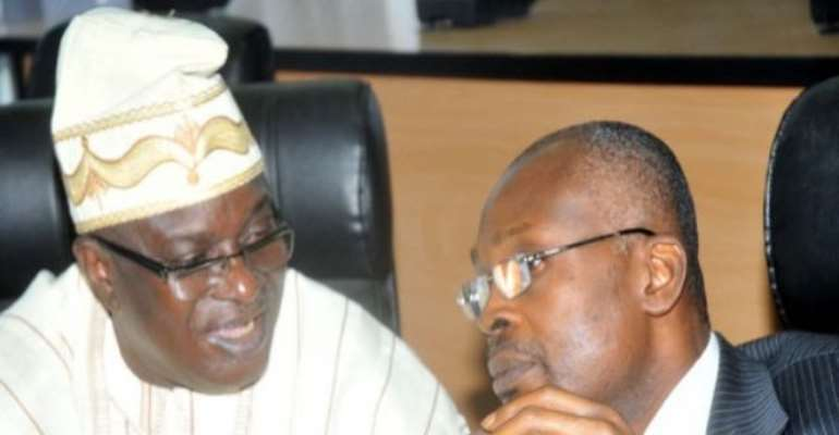 PHOTO: L-R: INEC ACTING CHAIRMAN, SOLOMON SOYEBI WITH NATIONAL COMMISSIONER, PHILLIP UMEADI.