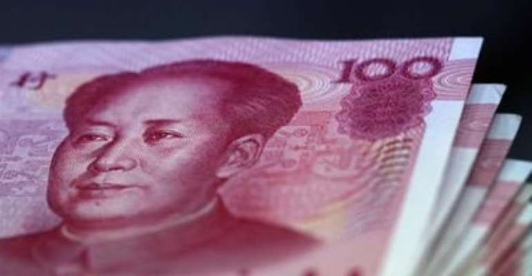 CHINESE YUAN NOTES ARE COUNTED INSIDE A BANK IN TAIPEI