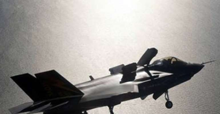 A F-35 FIGHTER JET PREPARES FOR LANDING WITH ITS LIFE FAN COVER DEPLOYED OVER PATUXENT RIVER NAVAL AIR STATION, MARYLAND IN THIS UNDATED HANDOUT IMAGE.