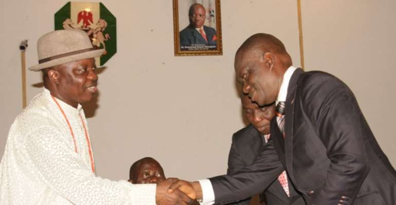 DELTA STATE GOVERNOR, DR EMMANUEL UDUAGHAN (L) CONGRATULATES MR MACAULAY OVUOZOURIE ON HIS APPOINTMENT WHILE EDO STATE GOVERNOR, COMRADE ADAMS OSHIOMHOLE LOOKED ON INSIDE THE GOVERNOR'S OFFICE ASABA, TODAY, JUNE 01, 2011.