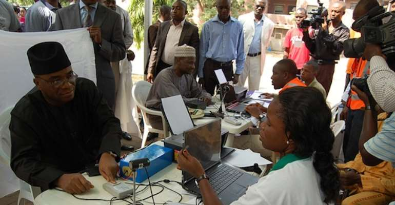 CHIEF OF NAVAL STAFF, VICE ADMIRAL OLA SA'AD IBRAHIM REGISTERS TO VOTE AT A REGISTRATION CENTRE IN ABUJA.