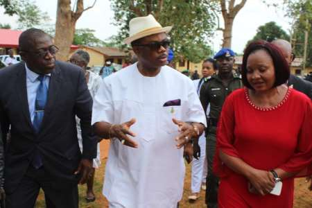Willie Obiano flanked by Anambra State Commissioner for Youth & Sports, Ogbuefi Hon Tony Nnacheta and Director of MDG