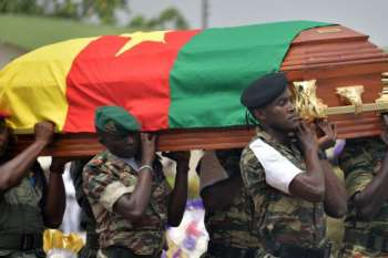 The remains of a Cameroonian soldier being carried in Yaounde by his colleagues
