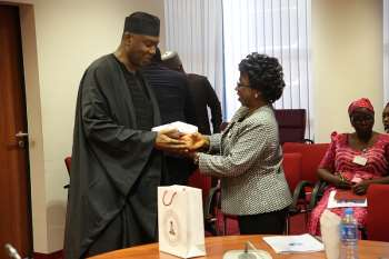 Senate President​ giving the leader of the QCOGA delegation, National President, Dr. Frances Funmi Ajose​, a souvenir from the office.