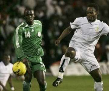 Nigeria's Seyi Olofinjana (L) challenges Ghana's Michael Essien for the ball during their international friendly soccer match at Griffin Park in Brentford February 6, 2007.