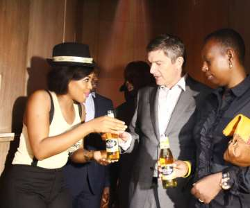 21-AN AMBASSADOR HANDING OVER BOTTLES OF STRONGBOW TO MANAGING DIRECTOR, NIGERIAN BREWERIES, NICHOLAAS VERVELDE AND HIS WIFE, CLEMENTINE VERVELDE