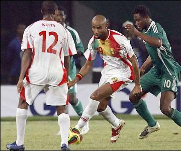 After scoring against Benin, Frederic Kanoute looks for a way through the Super Eagles's defence