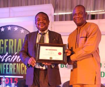 CHAIRMAN OF COSON BOARD, TONY OKOROJI RECEIVING AWARD