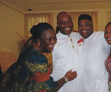 Governor Akpabio and wife, Unoma embracing Mr. Udom Gabriel and wife, Mather after the declaration of Mr. Udom Gabriel Emmanuel as winner of April 11, gubernatorial election in Akwa Ibom State.