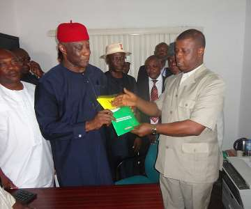 Former Minister of Interior Capt Emmanuel Ihenacho (L) being welcomed to the All Progressives Grand Alliance (APGA) National Secretariat Abuja by the party''s when the former minister went to obtain his Governorship Nomination and Expression of Interest forms to the All Progressives Grand Alliance (APGA) National Chairman Chief Victor Umeh at APGA National Secretariat Abuja.