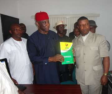 Former Minister of Interior Capt Emmanuel Ihenacho (L) presenting his Governorship Nomination and Expression of Interest forms to the All Progressives Grand Alliance (APGA) National Chairman Chief Victor Umeh at APGA National Secretariat Abuja.