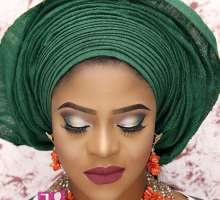 Former Face Of CandyCity Nigeria, Joyce Woke Looking Regal In Coral Smokey Eyes