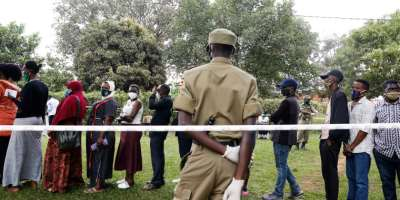 Voters queue to cast their ballots in Kampala, Uganda, on January 14, 2021. Internet access was cut throughout the country during the election. (Reuters/Baz Ratner)