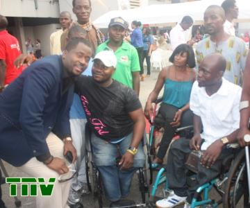 DESMOND ELLIOT WITH THE PHYSICALLY CHALLENGED SPORT MEN