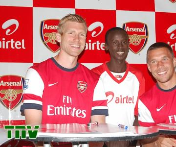 (L-R) Arsenal Defender, Per Mertesacker, ARS MVP, Yakubu Gambo and Arsenal Striker, Lukas Podolski during the visit of the players to Nigeria as part of the partnership between the premiership side and Airtel Nigeria.